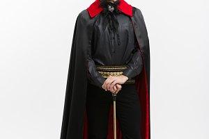 Vampire Halloween Concept - Full length Portrait of handsome caucasian Vampire in black and red halloween costume.