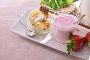 Yogurt and curd with honey on plate