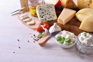 Creamy cheeses on table elevated