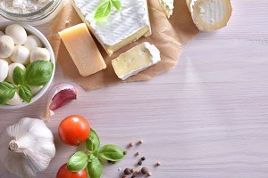 Cheese on white wooden table top