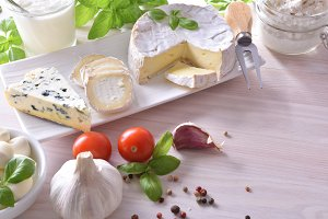 Cheese on white wood table elevated