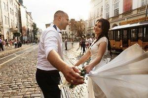 Cheerful adult wedding couple