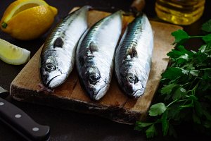Fresh mackerel on cutting board