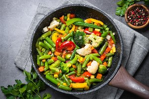 Stir fry vegetables in the wok.