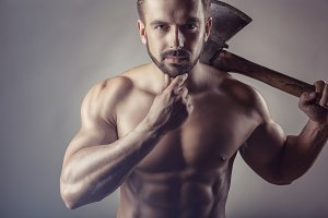 Body-builder with village ax