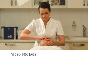 Massage therapist making facial