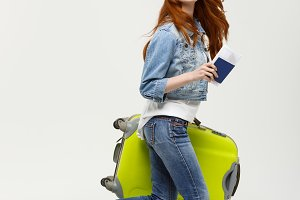 Travel and Lifestyle Concept - Portrait woman holding and running with a large suitcase and passport to vacation