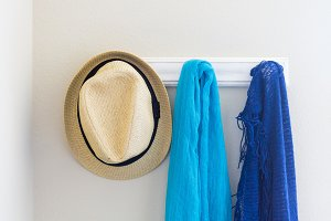 Scarfs, Hat Hanging on Wall in House
