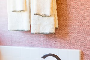 Bathtub, Faucet, Towels Abstract