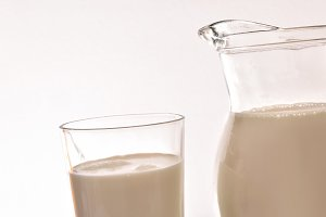 Jug and glass full of milk white