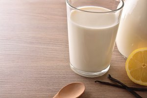 Glass of milk on table elevated