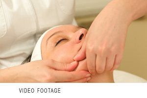Massage of face at beauty treatment