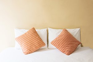 pillow on bed and with blanket