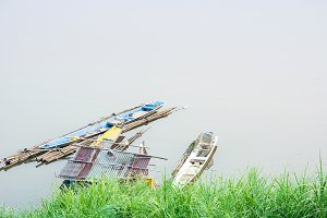 Old boat and old raft moored