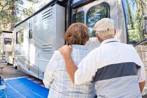 Senior Couple Looking At An RV