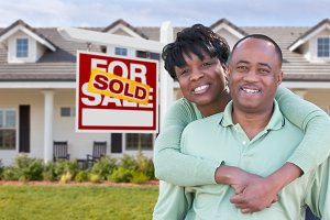 Couple In Front House & Sold Sign