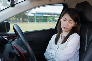 Woman sleep in car
