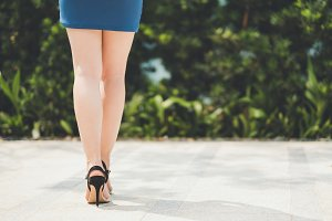 Woman in short skirt and high heel