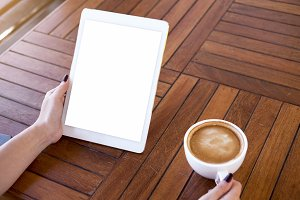 Blank screen tablet on wooden desk