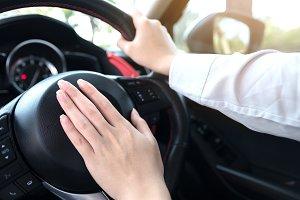 Pressing car horn for warning