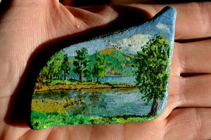 landscape drawing on a stone