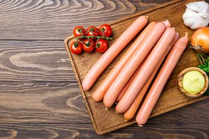 Raw frankfurter sausages
