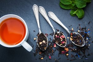Tea cup and assortment of dry tea