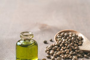 Hemp seeds and hemp oil, copy space. Vertical
