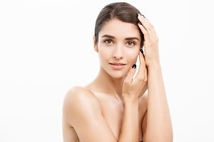 Beauty and spa concept - Charming young woman with perfect clear skin over white background.