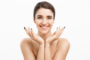 Health care and spa concept - attractive young and healthy woman with nude makeup on white background.