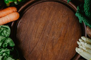 Wooden plate surrounded with fresh