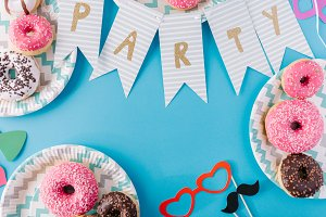Party flags and donuts on plates