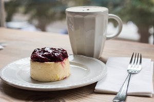 latte and cheese cake with cherries