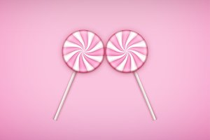 Two Pink Lolipops candy on pastel pink background.