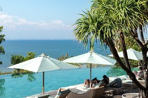 Infinity pool on the bright summer day. Bali island.