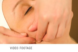 Massage treatment of womans face