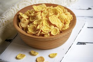 cornflakes in a wooden bowl