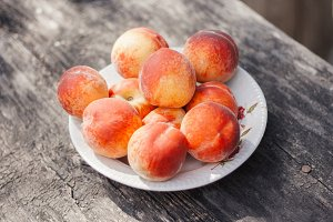 Peaches on a wooden background
