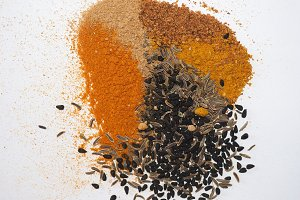 many spices including Ginger Curry Turmeric Chili pepper Black cumin Nigella sativa