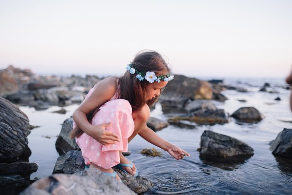 girl playing on sea shore