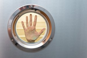 Female hand in porthole