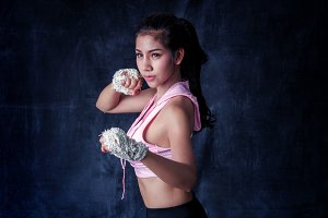 Sexy fighter girl with boxing wraps.