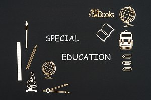 School supplies placed on black background with words special education