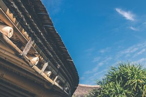 Bamboo roof against a blue sky. Bali island.