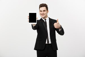 Business Concept: smiling businessman with tablet showing thumbs up over gray studio background