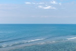 Beautiful sea with blue sky on sunny day. Ocean landscape. Bali island.