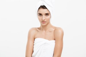 Beauty and Skin care concept -Beautiful caucasian young woman wearing towel after shower