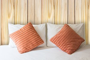 white pillow and orange pillow