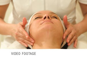 Woman relaxing during facial therapy