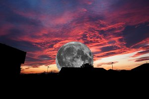 Full moon over dramatic red sky